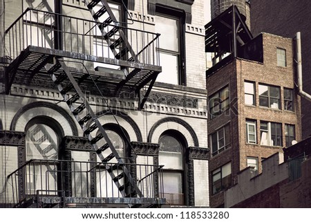 Metal fire escape on facade of old building in New York City