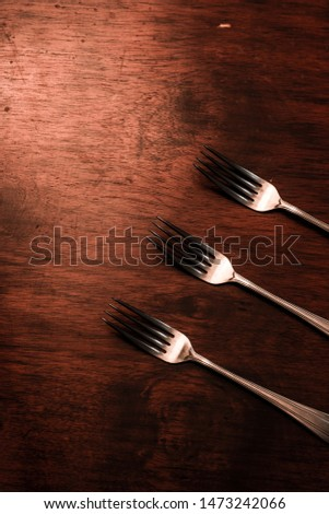 metal forks for eating on wooden table