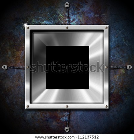 Metal Frame on a Grunge Wall Empty metallic frame on a grunge blue background