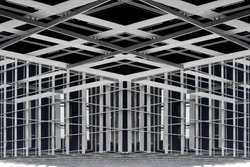 Metal framework of modern building. Supporting structures. Reworked photo of industrial architecture fragment. Construction industry. Abstract grid background.