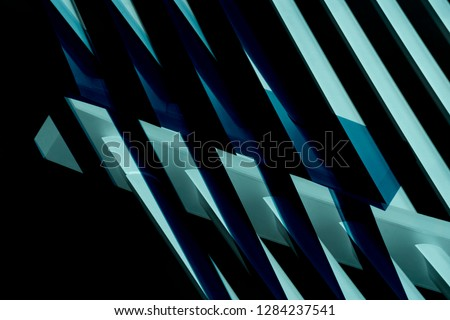 Metal framework structure of contemporary office building. Abstract modern architecture background with parallel light and dark stripes.