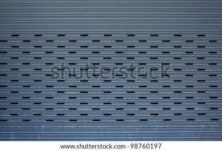 metal garage door gate store roller shutter. closeup Useful as background for design-works
