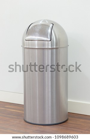 Metal garbage bin on the floor