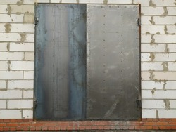 Metal gate in the wall