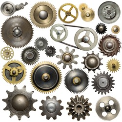 Metal gear, cogwheels, pulleys and clockwork spare parts.