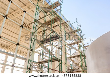 Metal girder extensive scaffolding providing platforms for stage structure support #573165838