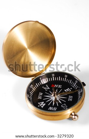 Metal gold-looking compass isolated over white background