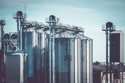 Metal grain elevator in agricultural zone. Grain silo, warehouse or depository is an important part of harvesting.
