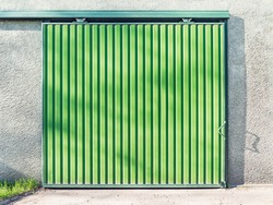 Metal green gate of the big storage.