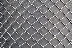 metal grid pattern and texture background, abstract industrial metallic surface, shiny aluminum mesh on grey textured iron pole, steel wire security fence, isolated outdoors, grunge backdrop