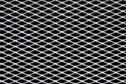 metal grid with regular pattern on black background