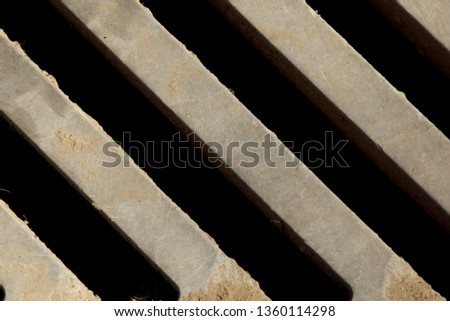 metal grill close-up. view from above. oblique lines. background, structure. drain grate #1360114298