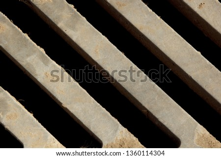 metal grill close-up. view from above. oblique lines. background, structure. drain grate #1360114304
