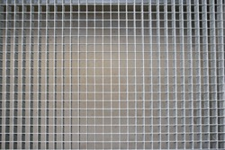 Metal grille on the floor of the industrial hall