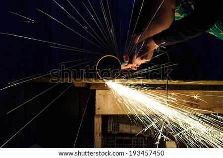 Metal grinding on steel pipe close up #193457450