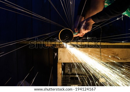 Metal grinding on steel pipe close up #194124167