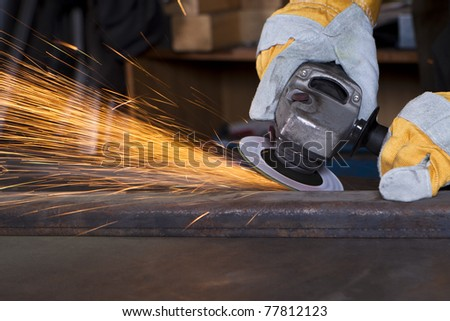 metal grinding with orange flying sparks