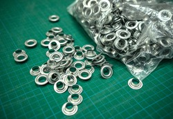 Metal grommets for fabric and advertising banners.