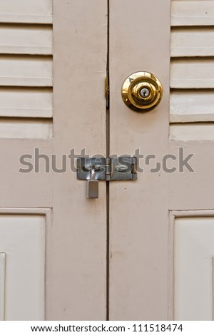 metal handle on a wooden door