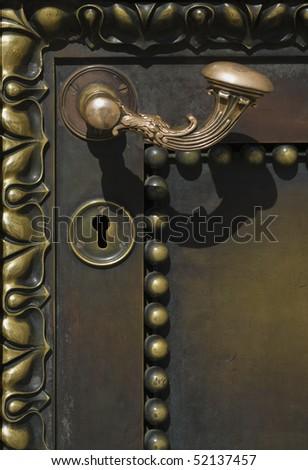 Metal handle on metal door