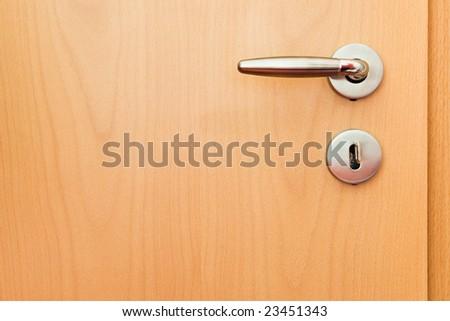 metal handle on wooden door