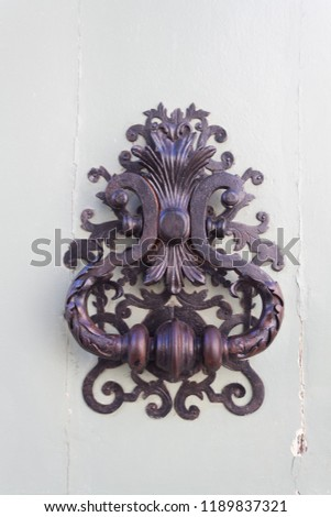 metal handle with ornate ornaments #1189837321