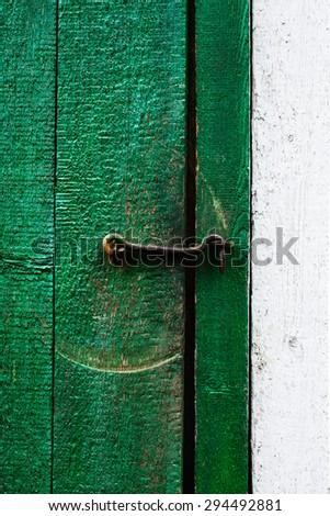 Metal hook in old wooden door