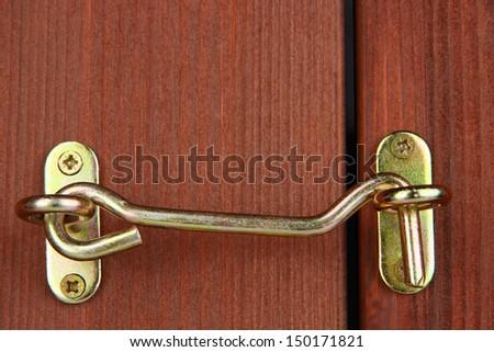 Metal hook in wooden door close-up