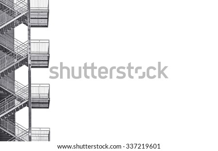 Metal industrial staircase isolated on white background. Black and white picture with plenty of copy space on the right