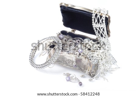 Metal jewelry open box with accessory on white background