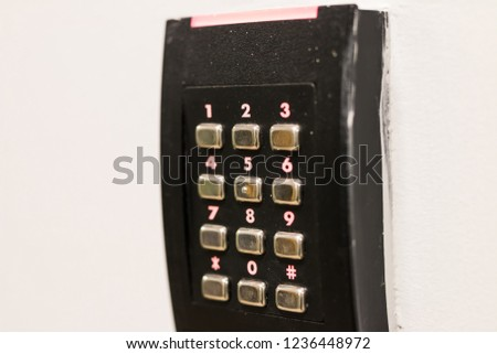 metal keypad with buttons #1236448972