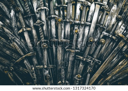 Metal knight swords background. Close up. The concept Knights. #1317324170