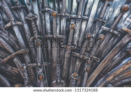 Metal knight swords background. Close up. The concept Knights. #1317324188