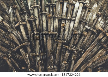 Metal knight swords background. Close up. The concept Knights. #1317324221