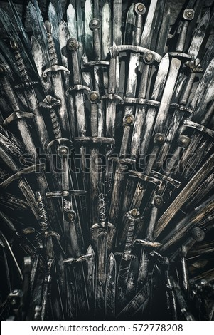 Stock Photo Metal knight swords background. Close up. The concept Knights.