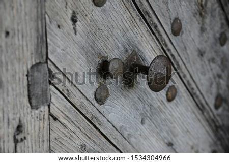 metal knob of vintage wooden door