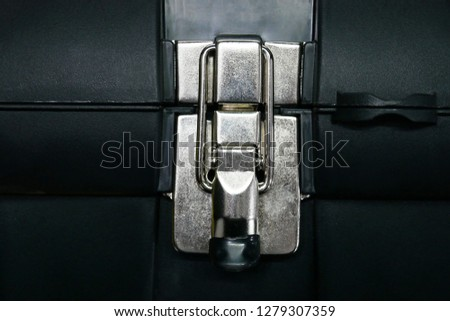 Metal latch close up on closed tool box. Protection security entrance