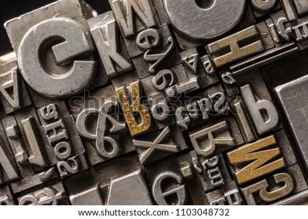 Metal Letterpress Types.  A background from many historical typography letters in black and white with white background.  #1103048732
