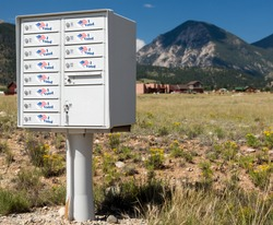 Metal mailbox container for rural homes with I Voted stickers as concept for voting by mail or absentee ballot paper