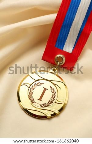 Metal medal on silk wrinkled cloth
