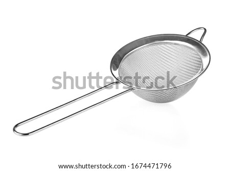 Metal mesh isolated on a white background. Tea strainer. Sieve for cooking. Stock photo ©