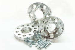Metal mold of flanges and bolts. CNC milling and lathe industry. Metal engineering. Indoors closeup on white background.