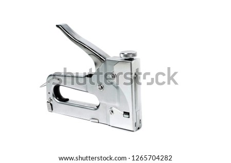 Metal Nickel plated stapler gun on white background, isolate close up.
