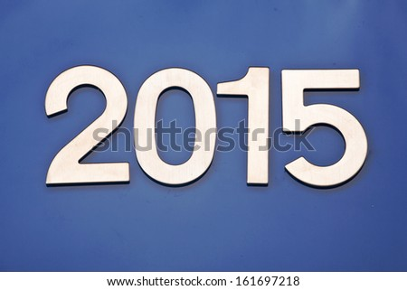 metal numbers of the year 2015 on a blue background