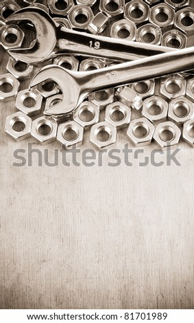 metal nuts on wood background