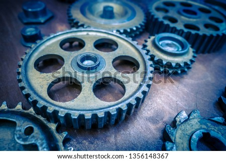 Metal old gears. Blue gears. Many gears of different sizes are on the table. #1356148367