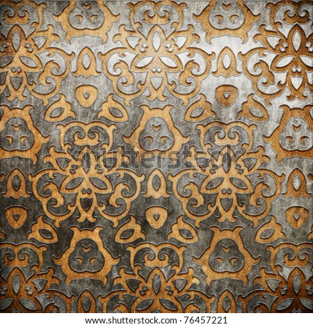 Metal ornament on old wooden background