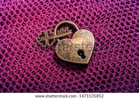 Metal padlock in heart shape as  symbol of love #1471535852