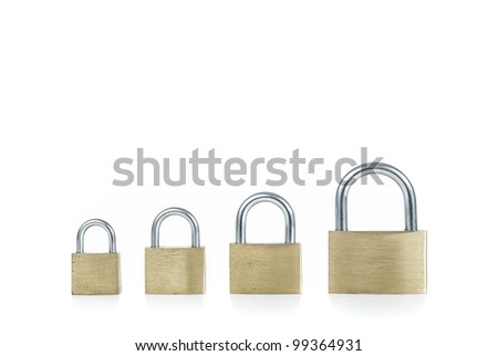 Metal padlocks of different sizes on white background