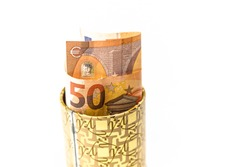 Metal piggy bank with Euro symbols for saving money. On a white background with euro banknotes. Saving Euros in a tin box. Keeping banknotes in an impromptu savings account. Concept High quality photo